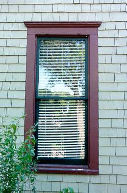 window with wood siding