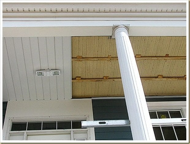 Beadboard porch ceiling is covered up with plastic to cover Freehold history.