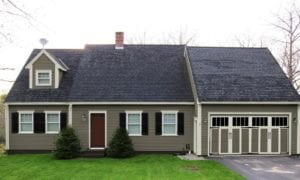 Paint colors, shutters, carriage house garage door and removal of storm door greatly improve curb appeal.