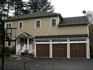 McMansion with new Garage doors.