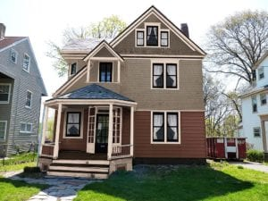 Alternative Victorian paint colors and period windows improve curb appeal.