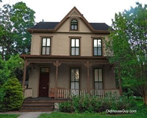 stucco victorian with dark colors