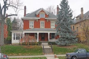 Orange Brick House With White Trim