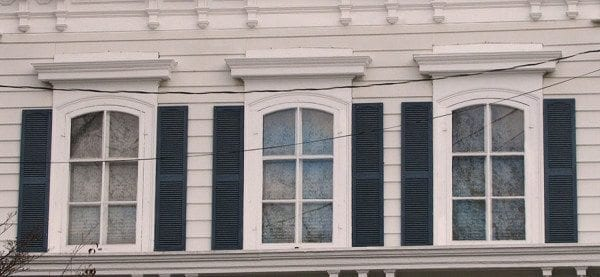 rectangular window shutters on arched italianate windows installed wrong