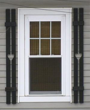 ugly board and batten shutters with narrow boards