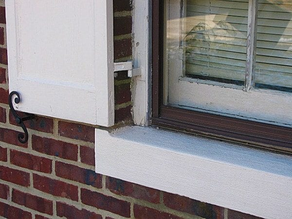 exterior shutter hinges attached to brick mold on brick house