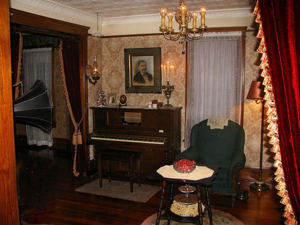 the restoration of a late victorian home view of parlor with player piano