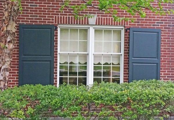 large wide green window shutters
