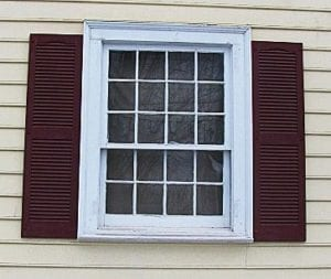 red narrow shutters on large wide window