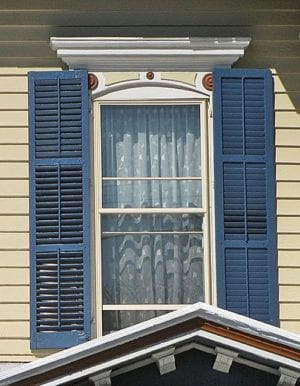 rectangular shutters on arched window