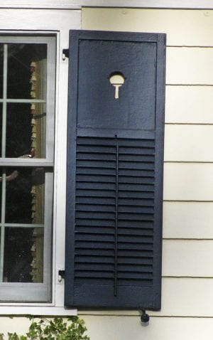black operable louvered shutters with cut outs