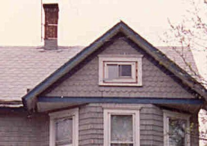 victorian side gable with decorative shingles