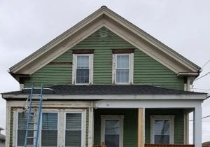 green vinyl siding removed