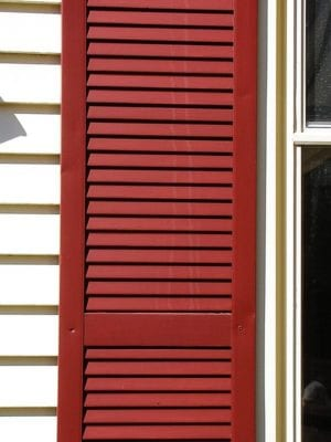 flat red vinyl shutters cheap looking