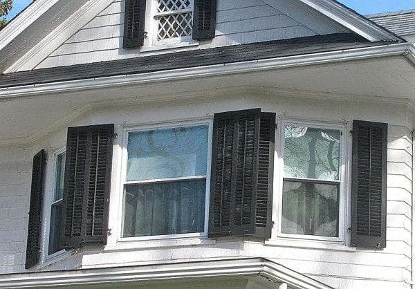 wide window overlapping shutters