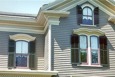 custom italianate arched storm windows