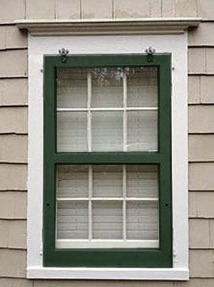 hanging wood storm window