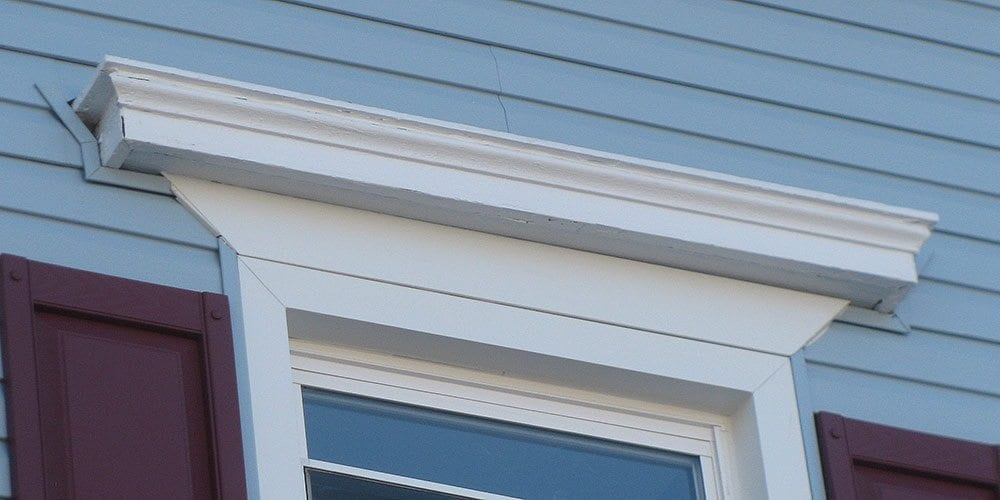 Historic house vandalized with plastic siding etc for Window header