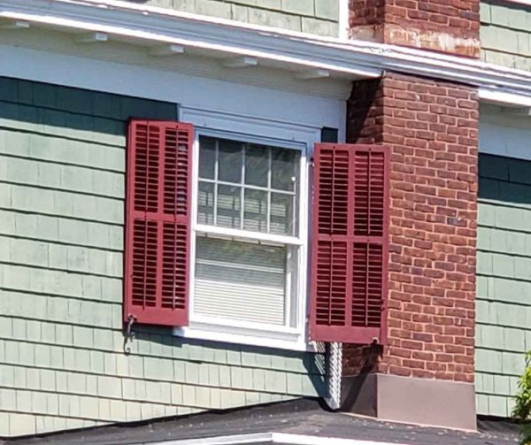 shutters next to chimney
