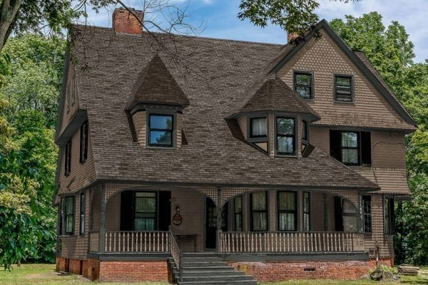 brown painted shingle style victorian