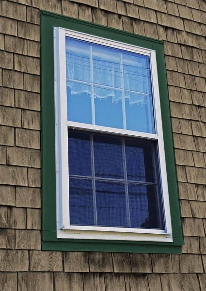 storm window on eastern style window casing