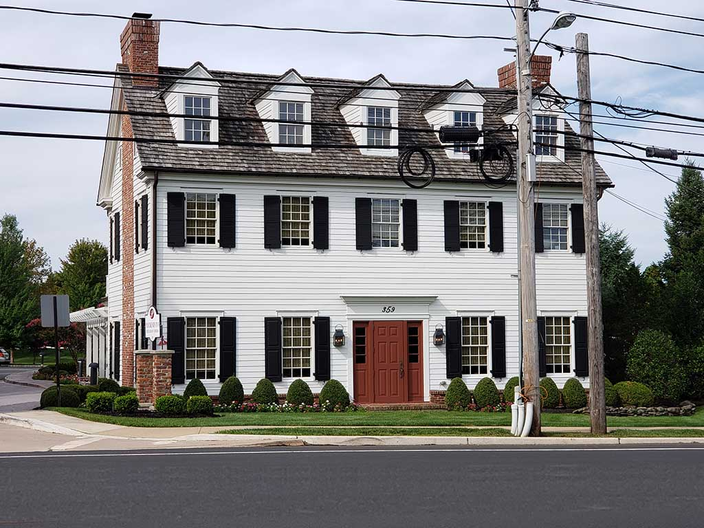 Colonial house with red door