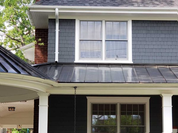 standing seam roof with white gutters